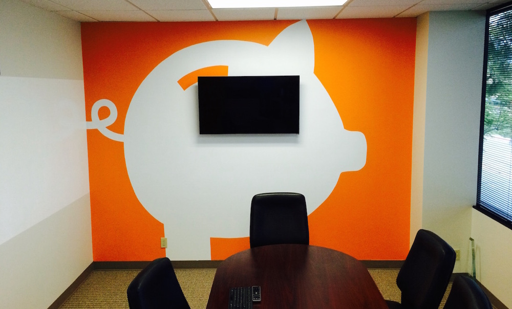 Freshly painted wall graphics of customer logo in conference room