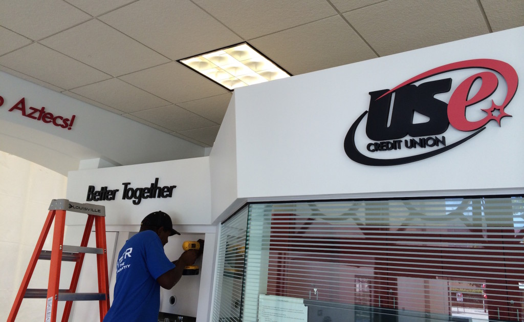 Our crew working on credit union branch rebranding in San Diego